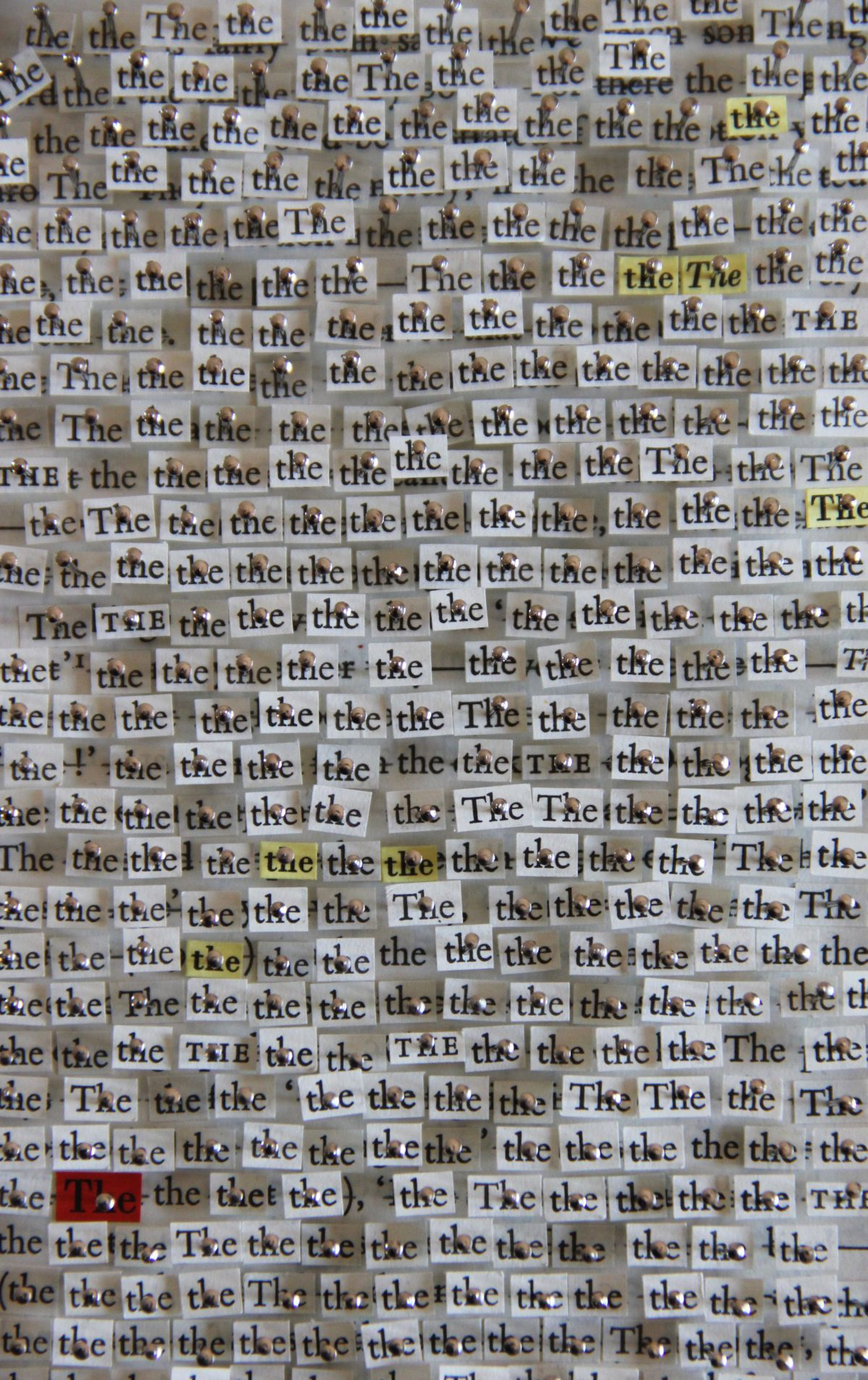 Click the image for a view of: Chloё Reid. 'the, of, and, to, a' (detail). 2013. Found text, pins. Dimensions variable
